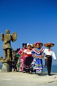 Puerto Vallarta children in traditional folkloric dance costumes on El Malecon waterfront