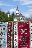 Hand-woven wool Romanian folk rugs for sale by local peasant weavers near Humor Painted Monastery in Bucovina
