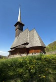 Wooden orthodox Church at Barsana Monastery complex in Maramures