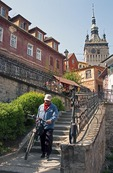 Stairs to medieval citadel town of Sighisoara (Schassburg in German), with clock tower above, in Transylvania