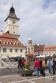 Brasov Town Hall or Council Square (Piata Sfatului) with local youth