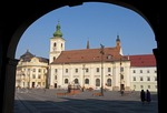 Romania's Sibiu City Hall and Holy Trinity Roman Catholic Cathedral tower on the Piata Mare Square pedestrian plaza