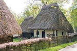 Romania's Museum of Traditional Folk Civilization, peasant homestead with thatch roof dwelling, at Sibiu in Transylvania