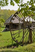 Romania's Museum of Traditional Folk Civilization water wheel and dwellings at Sibiu in Transylvania