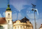 Reflection of Sibiu's Piata Mare Square in display window of a optician shop