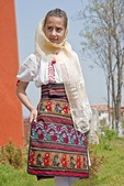 Romanian girl wearing traditional embroidered skirt at Histria Museum near Constanta