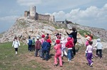 Ruin of Byzantine fortress of Heracleea near Enisala overlooking Lake Razim with Romanian school kids and teacher on outting