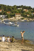 Croatia's Hvar harbour waterfront tourists, on island of Hvar in Adriatic