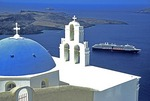 Santorini's Dome and Bell Tower of Greek Orthodox Church of Kimis Theotokov with cruise ship anchored below