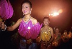 Thai women dancers carrying lotus lanterns at the Rose Garden in Bangkok