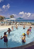 Sint Maarten: Morning aerobics in pool of the Divi Little Bay Resort