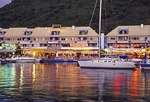 Saint Martin's Port La Royale Marina with restaurants at night in Marigot
