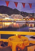 Saint Martin: Table at restaurant overlooking the Port La Royale Marina at dusk in Marigot