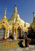 Yangon's Shwedagon Pagoda with Buddhist monk at altar