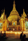 Yangon's Shwedagon Pagoda with Buddhist worshippers at night