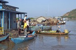 Cambodia's Tonle Sap lake floating village shops and shoppers