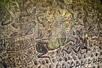 Cambodia's Angkor Wat bas relief stone carving of Mahabharata episode in west gallery depicting charioteer in battle pursuing enemy