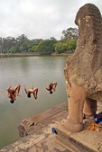 Cambodian boys diving into Angkor Wat moat west of the temple