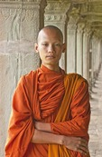 Young Cambodian monk in the temple of the Khmer ruins of Angkor Wat