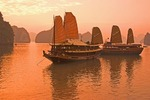 Vietnam tourist junks at sunset on Halong Bay