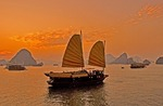 Vietnam tourist junks at sunset on Halong Bay in Gulf of Tonkin