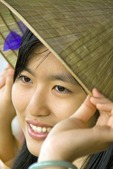 Young Vietnamese woman wearing traditional conical hat in Hue