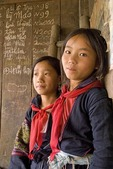 Black Hmong girls in village home near Sa Pa in northern hill tribe country of Vietnam