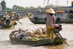 Vietnamese boats transporting produce in Mekong River Delta near Can Tho