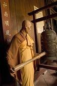Vietnamese monk ringing bell at Vinh Trang Pagoda Buddhist temple at My Tho in the Mekong River Delta