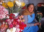 Bolivian flower vendor in Sucre city market