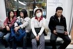 Beijing Subway passengers