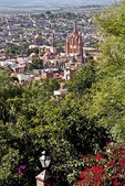 San Miguel de Allende's gothic spires of La Parroquia de San Miguel Arcangel (Church of St. Michael the Archangel) viewed from back yard of residence overlooking city