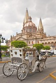 Guadalajara's Metropolitan Cathedral Templo Santa Maria de Gracia with horse drawn carriage