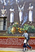 Ajijic villagers passing indigenous peoples mural