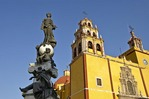 Basilica of Our Lady of Guanajuato with statue on fountain in  Plaza de la Pax