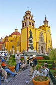 Guanajuato's Plaza de la Paz with musicians attracting a crowd, Basilica of Our Lady of Guanajuato in background