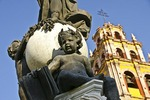 Cherub figure on staute on fountain in front of Basilica of Our Lady of Guanajuato
