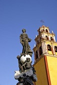Basilica of Our Lady of Guanajuato bell tower with statue on fountain in Plaza de la Pax