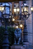 Guanajuato's Teatro Juarez wrought iron lamp posts and lion statue in evening