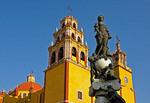 Basilica of Our Lady of Guanajuato with statue on fountain in Plaza del la Pax