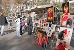 Artist on Las Ramblas in Barcelona selling paintings