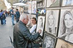 Artist on Las Ramblas in Barcelona sketching portrait