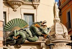 Las Ramblas icon, cast iron dragon on former umbrella shop, in Barcelona