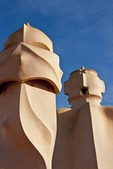 Antoni Gaudi sculpture (chimneys, vents) on roof of La Pedrera Museum in Barcelona