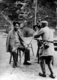 An assistant of legendary Chinese documentary photographer Wu Yinxian taking a photograph of Mao Zedong with a Kodak 4x5 view camera at the revolutionary base of Yan'an in 1945
