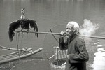 Guangxi cormorant fisherman smoking along the Li River near Xingping in Guilin area