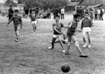 "Elementary school boys in Guilin playing soccer match in 1981 when slogan of ""Friendship First, Competition Second"", coined by Premier Zhou Enlai in 1971 for the visit of the U.S. ping pong team, was in fashion."