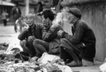Three farmers in market town of Yangshuo in Guangxi in 1981