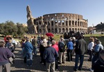 The Colosseum in Rome with tour guide and group of tourists