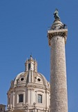 Trajan's Column in Trajan's Forum with Church of the Santissimo Nome di Maria